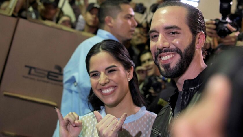 Salvadorean presidential candidate Nayib Bukele of the Great Alliance for National Unity and his wife, Gabriela Rodriguez, pose after voting during the Salvadorean presidential election in San Salvador on Feb. 3, 2019.