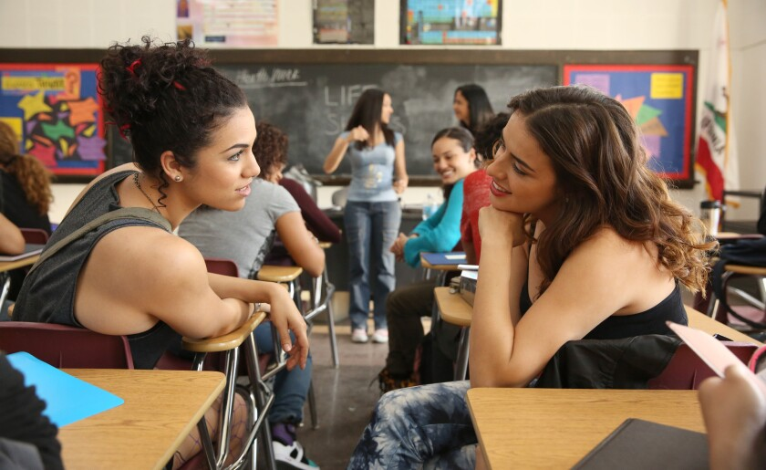 "Andrea Sixtos, left, and Vannessa Vasquez play best friends Jocelyn and Camila in the second season of the Hulu teen soap ""East Los High."""