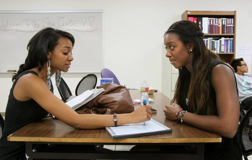 Physics student Jasmine West, at left, gets study assistance from physics tutor Krystle Osby at Cal State San Marcos.
