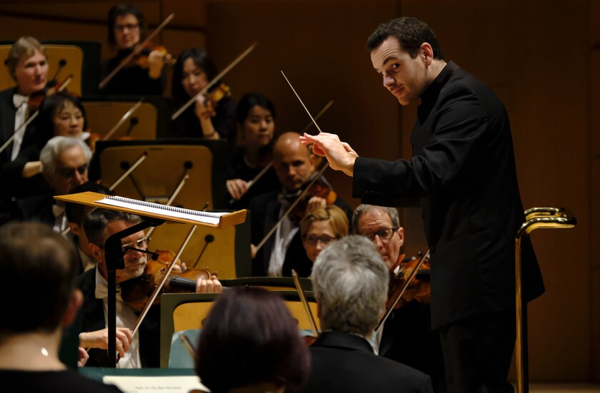 LOS ANGELES, CA January 19, 2017: Lionel Bringuier conducts at Walt Disney Concert Hall in Los Ang