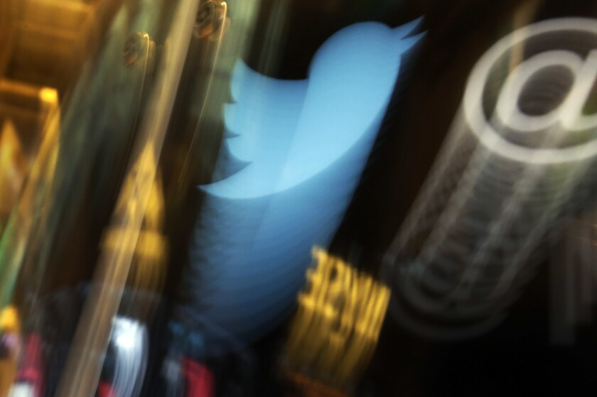 FILE - In this Wednesday Nov. 6, 2013, file photo, the Twitter logo appears on an updated phone post on the floor of the New York Stock Exchange. Hackers broke into the Twitter accounts of world leaders, celebrities and tech moguls in one of the most high-profile security breaches in recent years on Wednesday, July 15, 2020, highlighting a major flaw with the service millions of people have come to rely on as an essential communications tool. (AP Photo/Richard Drew, File)