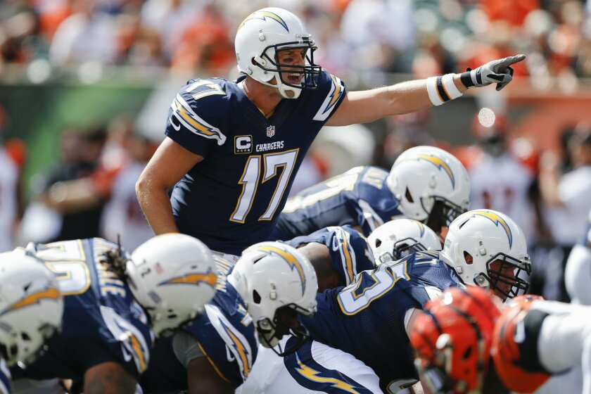 San Diego Chargers quarterback Philip Rivers (17) directs teammates before a play in the first half of an NFL football game against the Cincinnati Bengals, Sunday, Sept. 20, 2015, in Cincinnati. (AP Photo/Gary Landers)