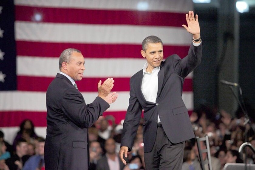 President Barack Obama and Massachusetts governor Deval Patrick, left, wave to the audience after Obama spoke on behalf of Patrick's re-election campaign at the Hynes Convention Center in Boston.