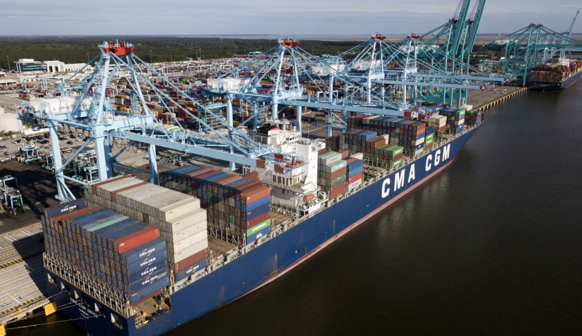 FILE - In this May 9, 2019, file photo a container ship is unloaded at the Virginia International Ga
