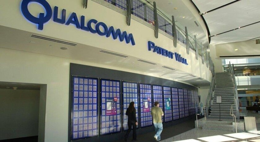 Patents issued to Qualcomm are displayed on the Patent Wall at the company's headquarters in Sorrento Valley.
