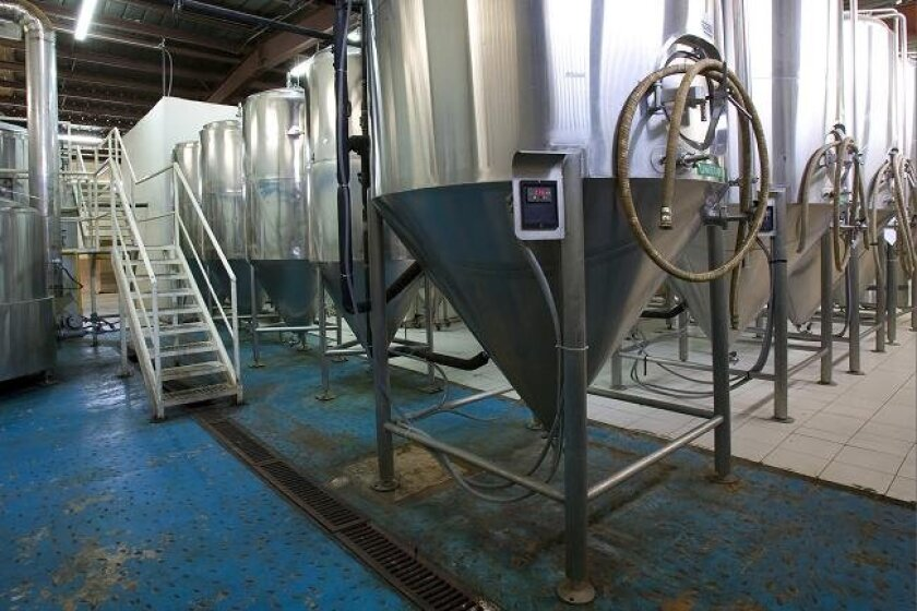 The large stainless-steel fermenting tanks in the Cucapa brewery.