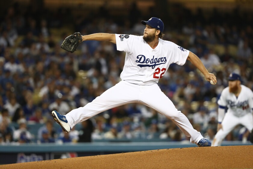 Dodgers pitcher Clayton Kershaw pitches against the Washington Nationals in the NLDS at Dodger Stadium.
