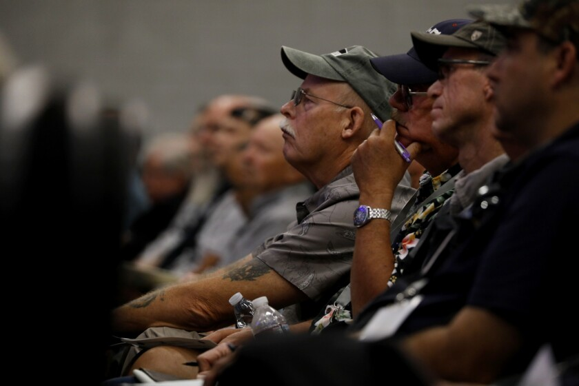 The audience listens as speakers discuss church security at a seminar sponsored by the California Rifle & Pistol Assn. at Mariners Church in Huntington Beach on Monday.