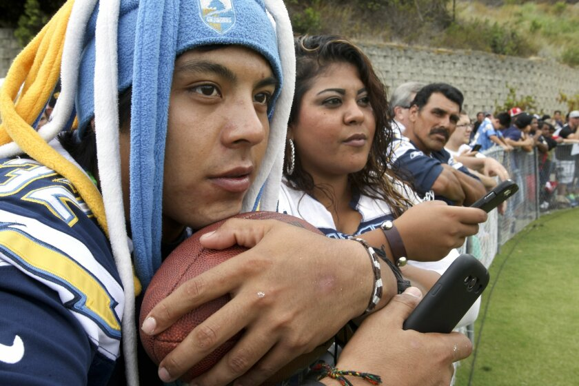 Chargers fan Egan Arreguin, from Vista, watches the Chargers during Chargers training camp at Chargers Park in San Diego on Friday, July 26, 2013.