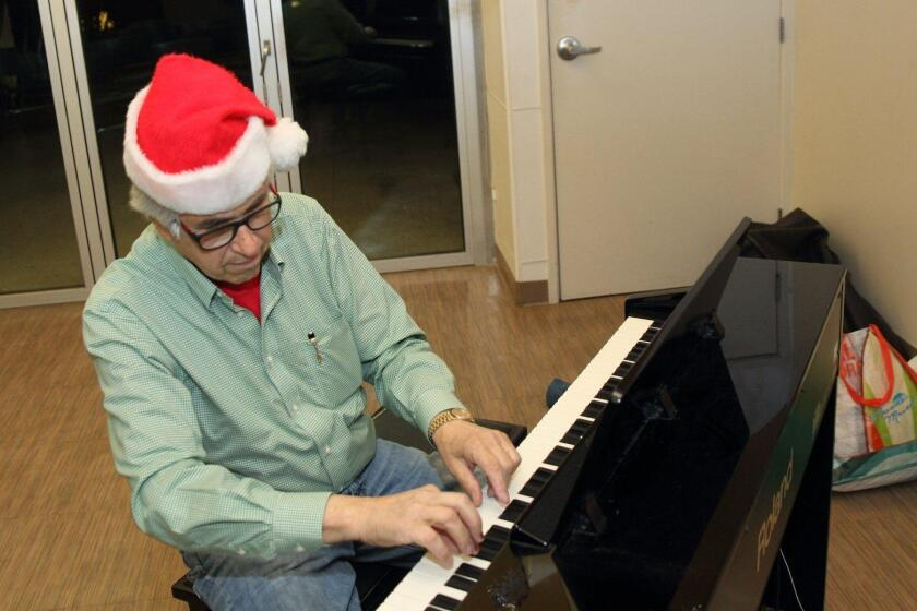 Dr. Ed Siegel warms up the piano