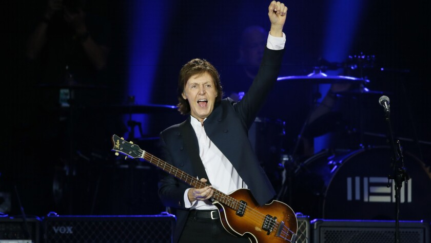Paul McCartney performs in 2015 at the Stade de France in Saint-Denis near Paris.