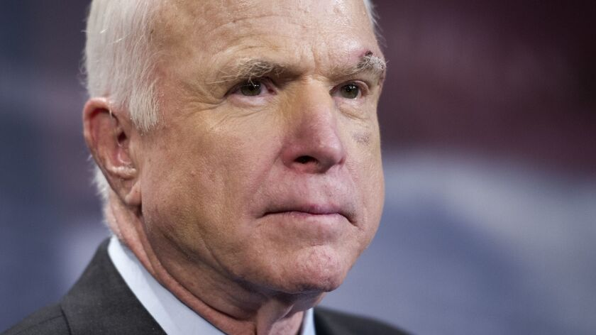 Sen. John McCain, R-Ariz., speaks to reporters on Capitol Hill in Washington, Thursday, July 27, 201