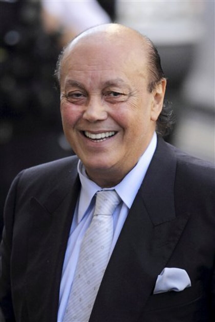 Tycoon Asil Nadir arrives for a hearing at the Old Bailey court in London, Friday, Sept. 3, 2010. The tycoon who fled Britain almost two decades ago following the spectacular collapse of his business empire recently returned to London to face charges of fraud. (AP Photo/Matt Dunham)