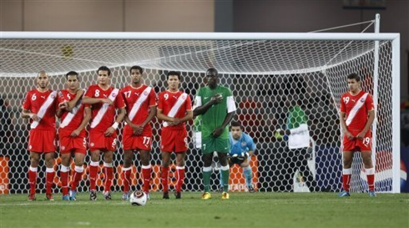 Tunisia players prepare to defend against a penalty kick by Zambia during their African Cup of Nations Group D soccer match at Tundavala Stadium in Lubango, Angola Wednesday, Jan. 13, 2010. (AP Photo/Rebecca Blackwell)
