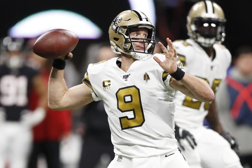 New Orleans Saints quarterback Drew Brees throws a pass against the Atlanta Falcons during the third quarter on Nov. 28 in Atlanta.