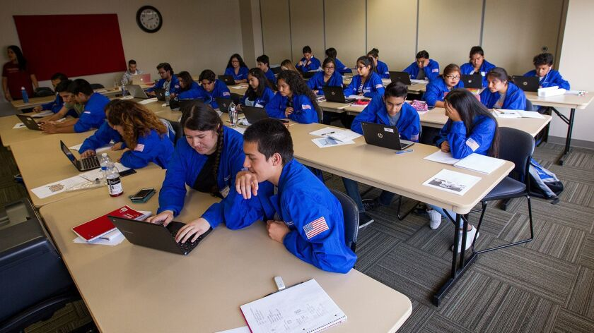 High school students participate in the Achievement Institute of Scientific Studies, a college to ca