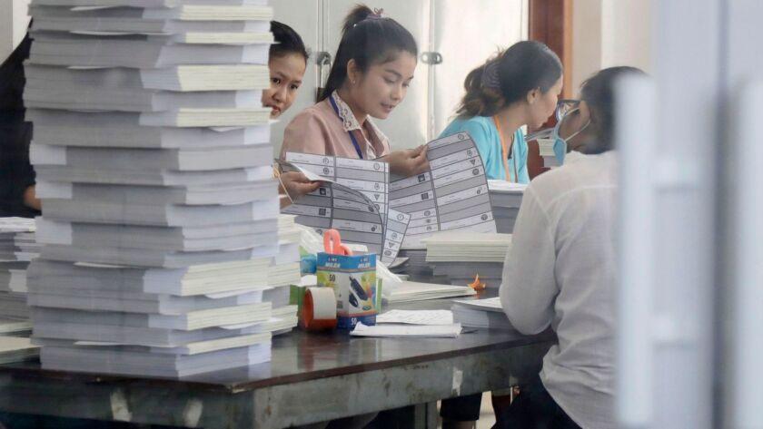 Cambodian National Election Committee shows sample ballots, Phnom Penh, Cambodia - 15 Jun 2018