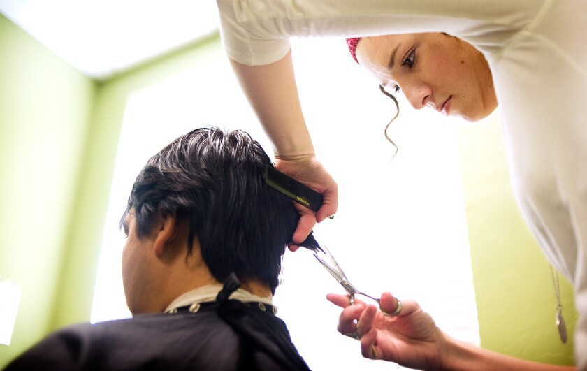 A Marinello Schools of Beauty student cuts hair in Provo, Utah, in 2010.