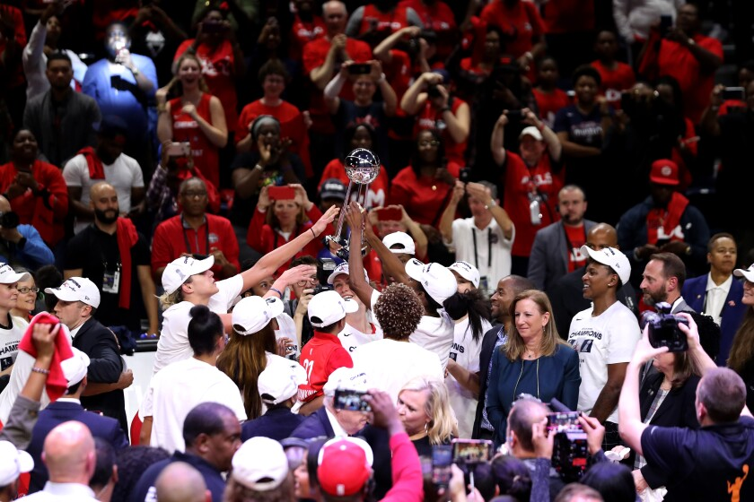Members of the Washington Mystics celebrate after defeating the Connecticut Sun to win the  2019 WNBA Finals on Oct. 10.