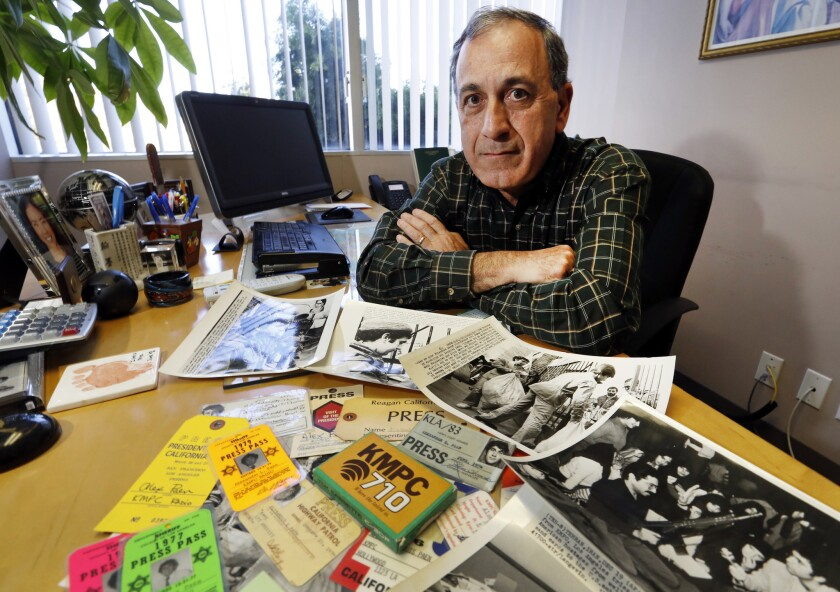 Alex Paen with press passes, photos and memorabilia in his Santa Monica office where he is founder and president of Telco Productions, Inc.