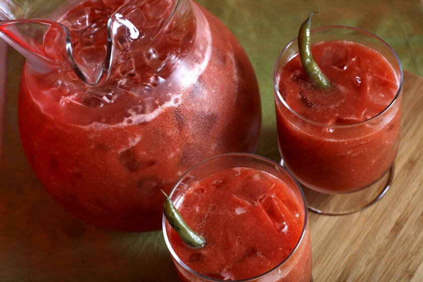IN THE MIX: Ripe tomatoes and seasonings make for a fresh Bloody Mary.