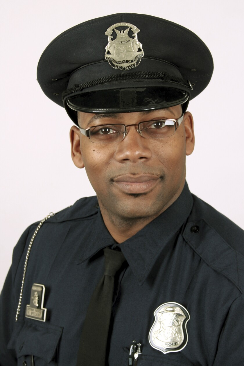 """This undated photo provided by the Detroit Police Department shows Officer Rasheen McClain. A gunman who fatally shot Detroit officer McClain and wounded another was trying """"to bait"""" them as they searched a home for him, police Chief James Craig said Thursday, Nov. 21, 2019. McClain was shot in the neck. His partner, officer Phillippe Batoum-Bisse, was shot in the leg. """"He was a leader, very tactical, very much about doing a great job,"""" Craig said about McClain. (Detroit Police Department via AP)"""