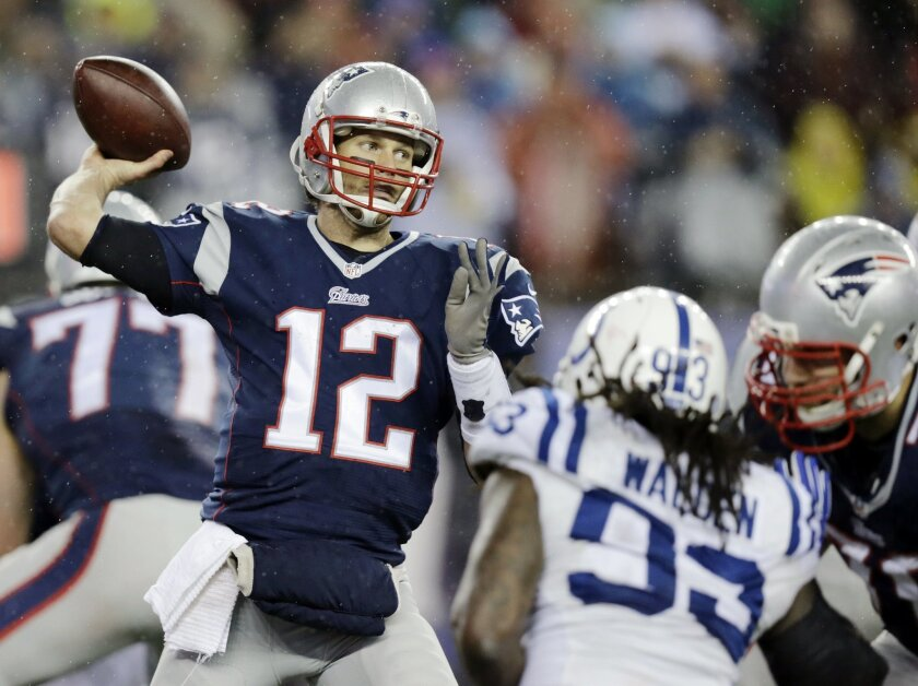 In this Jan. 18, 2015, file photo, New England Patriots quarterback Tom Brady (12)  passes against the Indianapolis Colts during the second half of the NFL football AFC Championship game in Foxborough, Mass. (AP Photo/Charles Krupa, File)