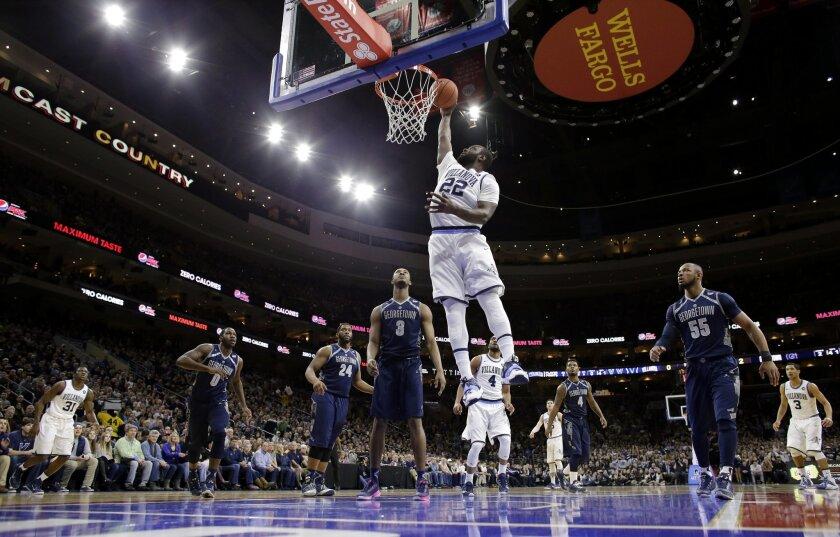 Villanova's JayVaughn Pinkston (22) goes up for a dunk during the first half of an NCAA college basketball game against Georgetown, Saturday, Feb. 7, 2015, in Philadelphia. (AP Photo/Matt Slocum)