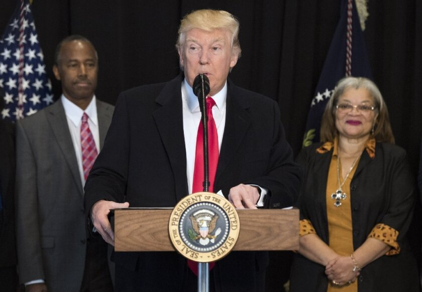 President Donald Trump delivers remarks after touring the National Museum of African American History and Culture on Tuesday in Washington, D.C. Trump was joined by Dr. Ben Carson and Alveda King, niece of Martin Luther King Jr.