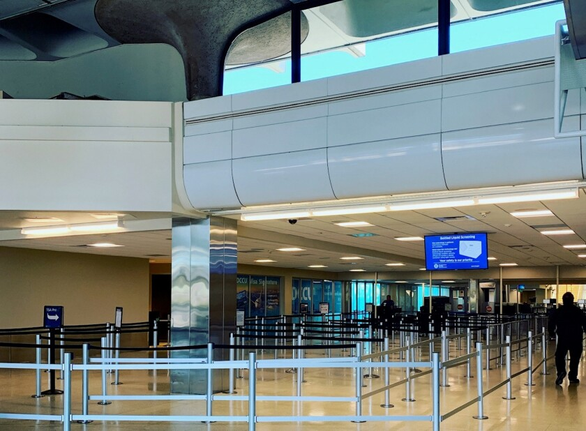The San Diego airport's Terminal 1 has no lines for security screening amid the COVID-19 pandemic, which has discouraged most people from flying.