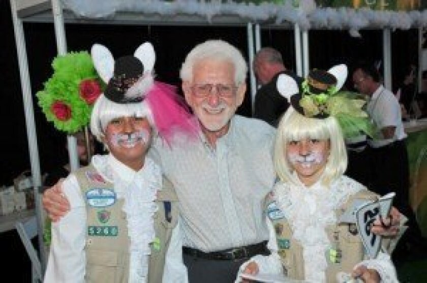 Marty Cooper with costumed Girl Scouts Magdalena Umada and Nicole Kellis. Cooper's wife, Arlene Harris, (not pictured) also attended the fundraiser.