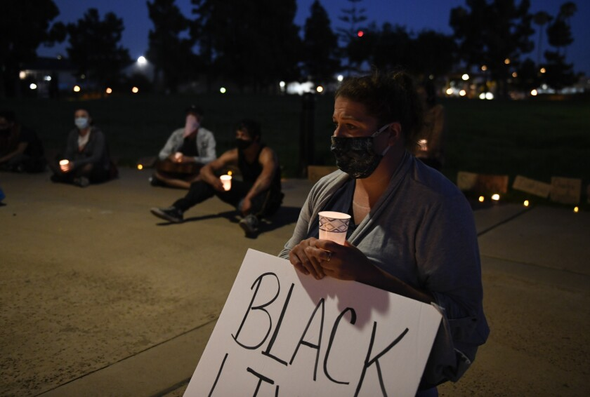 Candlelight vigil held at Veteran's Park to protest police brutality.