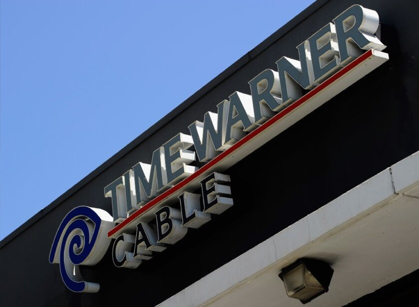 A sign hangs on a Time Warner Cable office on August 3, 2011 in Los Angeles, California.