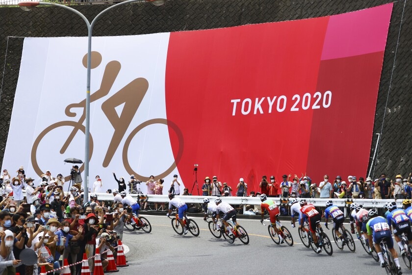 Cyclists compete in the men's cycling road race at the 2020 Summer Olympics, Saturday, July 24, 2021, in Oyama, Japan. (Tim de Waele/Pool Photo via AP)