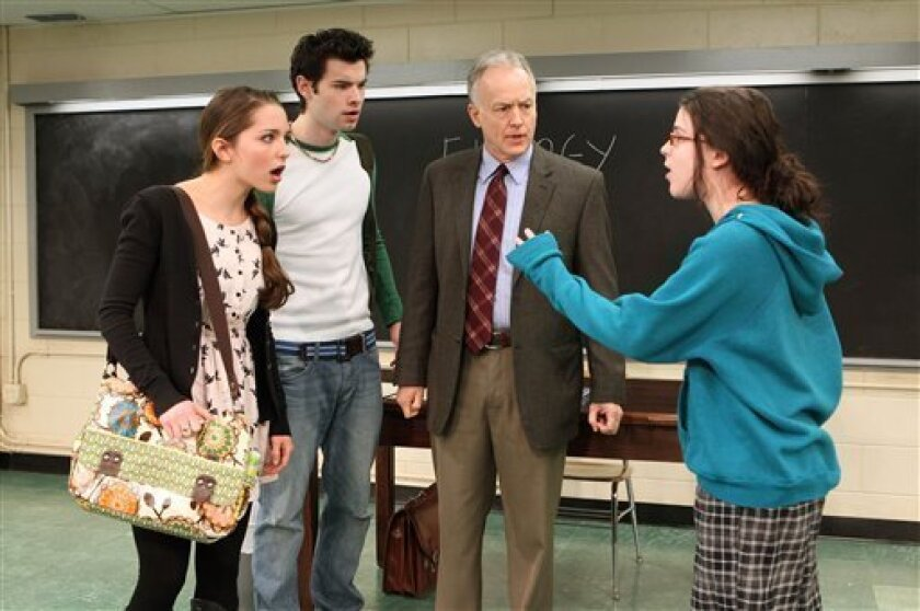 "In this publicity image released by Boneau/Bryan-Brown, from left, Jessica Rothenberg, Jake O'Connor, Reed Birney and Alexandra Socha, are shown in a scene from ""The Dream of the Burning Boy,"" performing off-Broadway at Roundabout Underground's Black Box Theatre at the Harold and Miriam Steinberg C"
