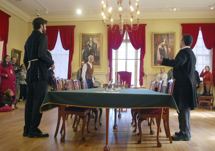 """In this 2015 photo provided by the Bostonian Society, costumed actors perform a reading of """"Blood on the Snow"""" in the Council Chamber of the Old State House in Boston. The play, inspired by the 1770 British slaughter of American colonists, will be presented to the public from May 12-29, 2016, in the very same room where the colonists agonized over how to respond to the killings, now known as the Boston Massacre. (Heather Rockwood/Bostonian Society via AP)"""