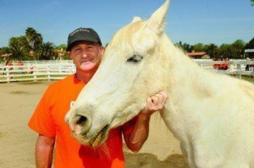 Gary Adler, president and CEO of Pegasus Rising, with Lady Avalon (Photo: Jon Clark)