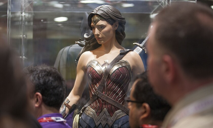 Fans take in the new Wonder Woman costume July 8 at Comic-Con in San Diego.