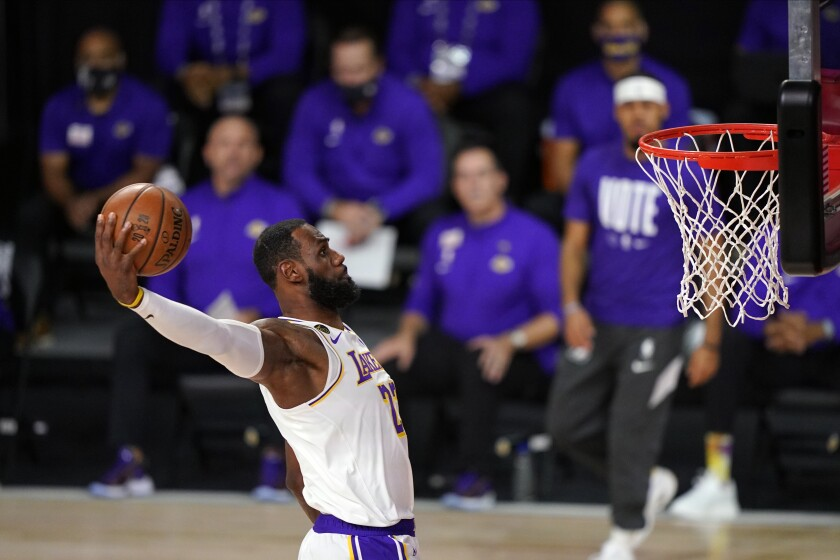 Lakers star LeBron James dunks during Game 6 of the 2020 NBA Finals in October.