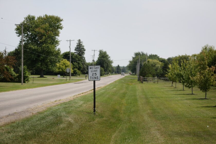 The area where an 18-year-old Michigan woman disappeared after she stopped her car to check on someone who was lying down on the side of Dean Road at Crabb Road in Bedford last night on Friday Aug. 8, 2014. Authorities say the 18-year-old Michigan woman who went missing after reporting she'd stopped to check on a person lying in a roadside ditch has been found alive in suburban Detroit. (AP Photo/Detroit Free Press, Romain Blanquart)