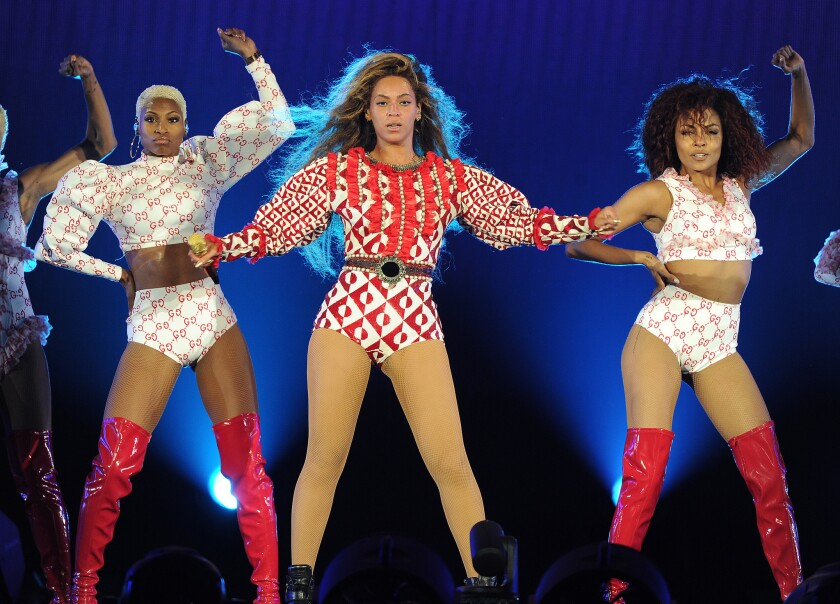 Beyoncé performs in a red and ivory geometric sequined bodysuit by Gucci, one of several looks created for her by the Italian luxury label, on the April 27, 2016, opening night of her Formation World Tour in Miami.