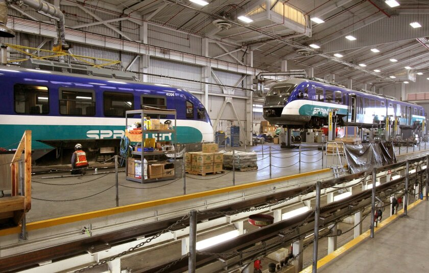 View of two Sprinter trains parked in NCTD's Escondido Sprinter maintenance facility.