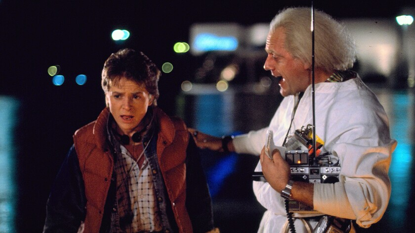 Michael J. Fox and Christopher Lloyd in the 1985 movie BACK TO THE FUTURE. Cr: Universal.
