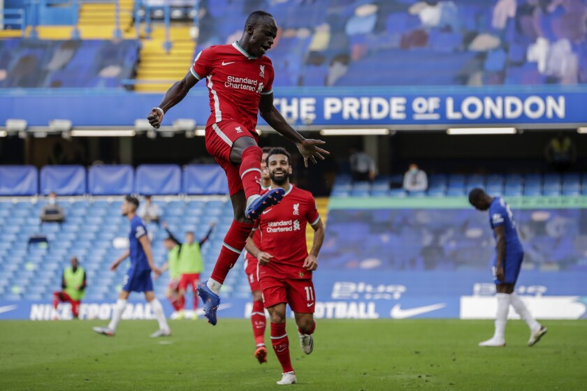 Liverpool's Sadio Mane celebrates after scoring during the English Premier League soccer match between Chelsea and Liverpool at Stamford Bridge Stadium, Sunday, Sept. 20, 2020. (AP Photo/Matt Dunham, Pool)