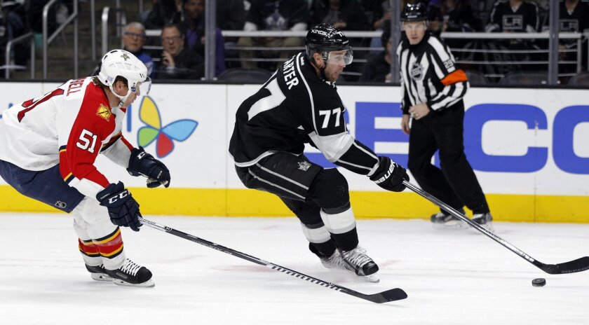 Los Angeles Kings center Jeff Carter (77) shoots on a break away, with Florida Panthers defenseman Brian Campbell (51) trailing during the second period of an NHL hockey game in Los Angeles, Saturday, Nov. 7, 2015. (AP Photo/Alex Gallardo)