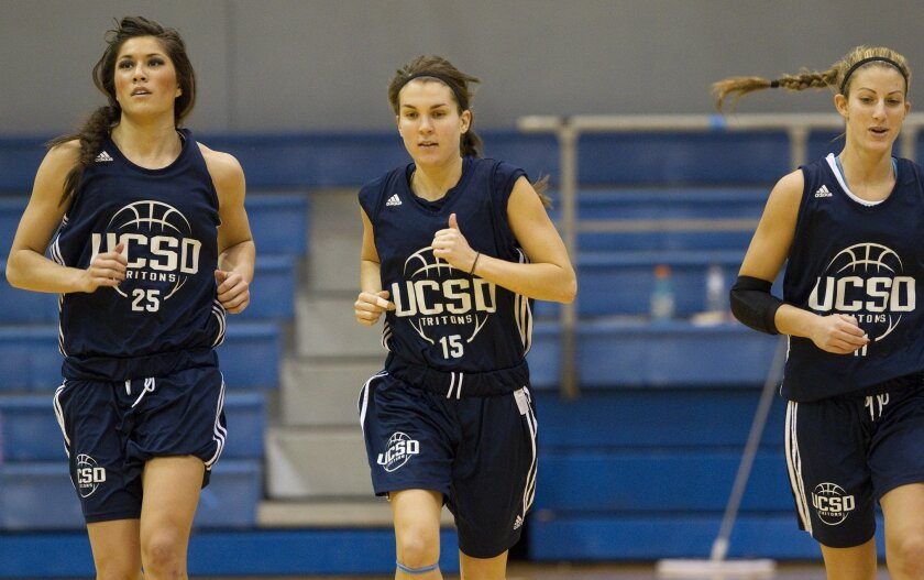 UCSD's Chelsea Carlisle (center) works out with teammates Lauren Freidenberg (left) and Daisy Feder (right) during UCSD women's basketball practice with her team.