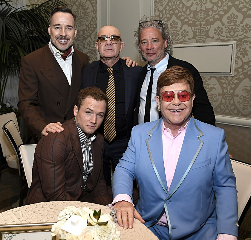 David Furnish, Bernie Taupin, Dexter Fletcher, Elton John and Taron Egerton