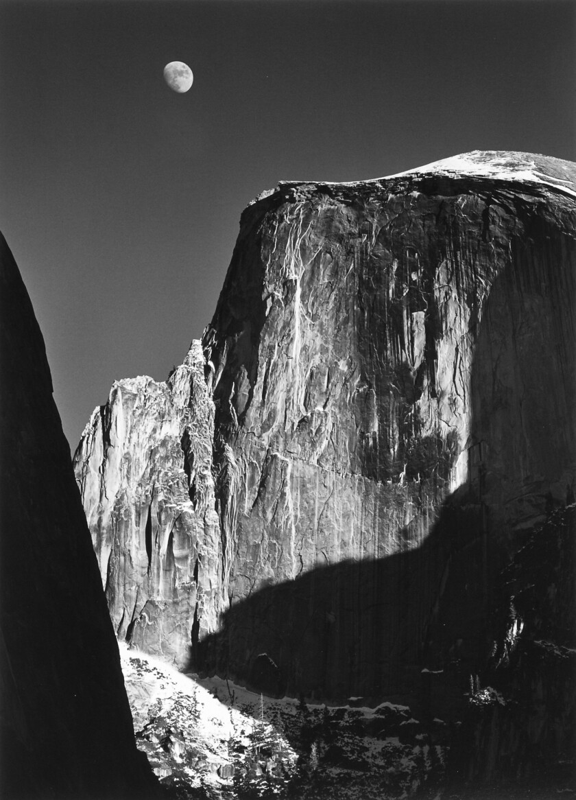 """Moon and Half Dome, Yosemite Valley,"" photographed by Ansel Adams."