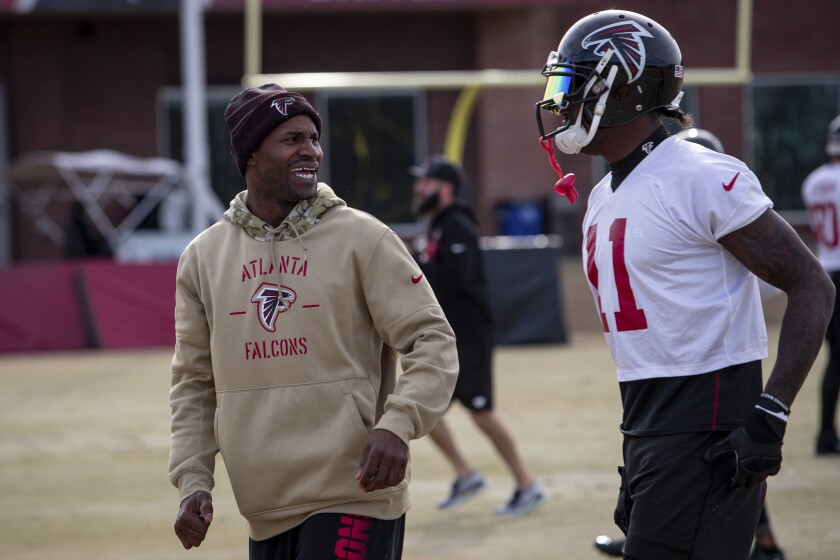 Atlanta Falcons coach Lance Schulters talks to wide receiver Julio Jones, right, during practice. Schulters faced a dilemma when his decade as an NFL player was ending. Schulters knew he wanted to continue in the game, possibly in coaching. The problem: He was told to basically start from scratch, sort of like a proven chef being told to work the grill at McDonald's.(Kara Durrette/Atlanta Falcons via AP)