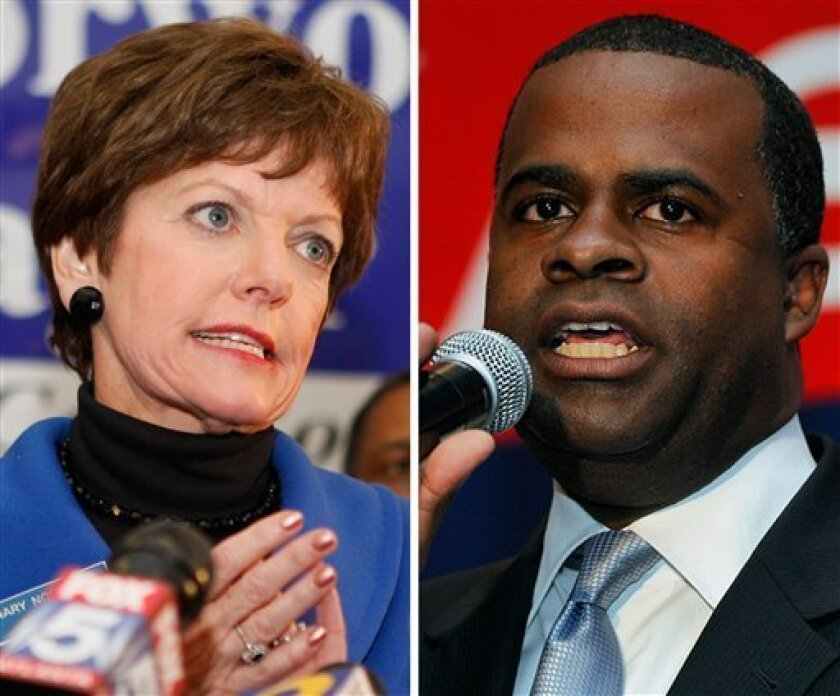 Atlanta Mayoral candidates Mary Norwood, left and Kasim Reed speak to supporters during their runoff election night parties, Tuesday, Dec. 1, 2009, in Atlanta. With a slim lead of 620 votes, Reed claimed victory in the race, though the contest was too close to call and appeared headed for yet another rematch. Norwood told supporters that she was not conceding and was open to a recount. (AP Photo)
